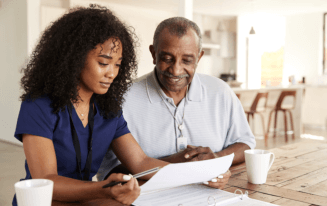 caregiver helping patient in reading