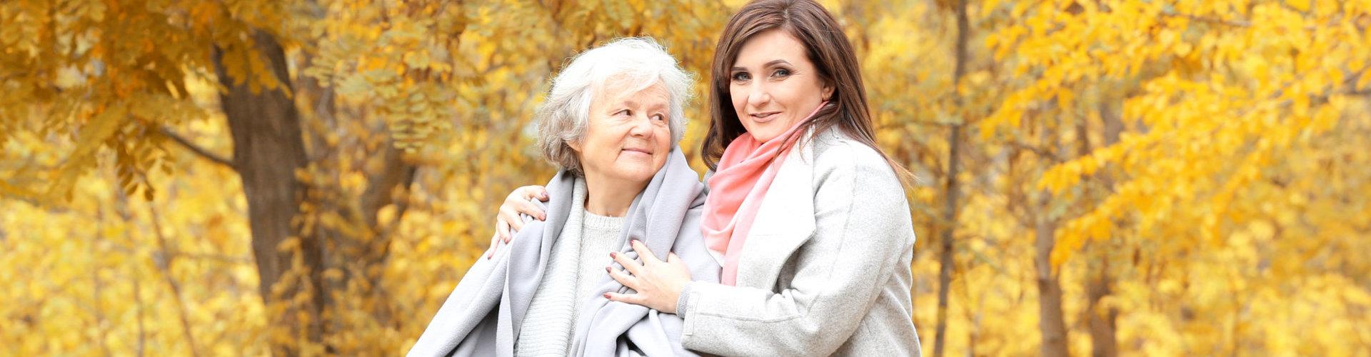 patient and caretaker smiling