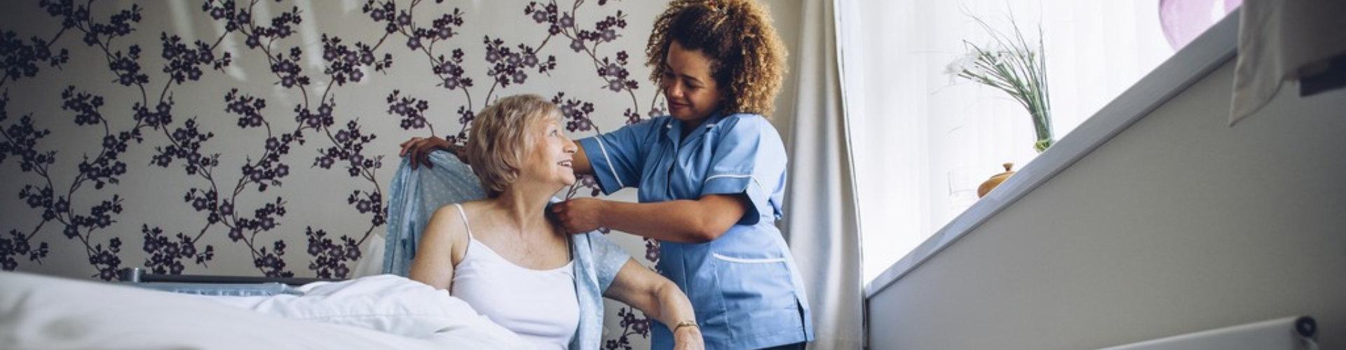 nurse dressing up patient